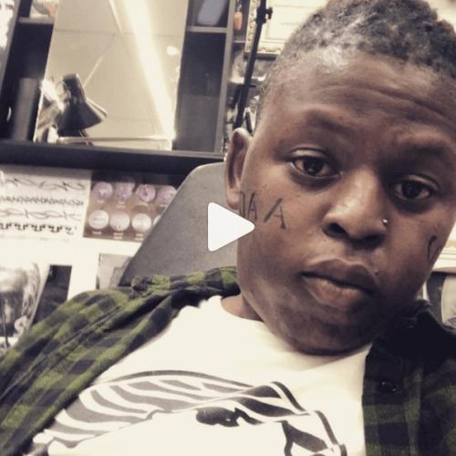 Distruction Boyz' Que face tattoo
